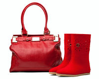 Pair of red felt boots and leather bag, with path Royalty Free Stock Images