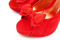 Pair of red female shoes, closeup. Pair of red female shoes over white background royalty free stock images