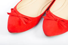 Pair of red female shoes, closeup. Pair of red female shoes over white background royalty free stock photography