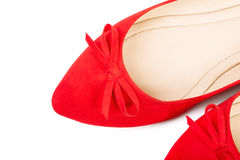 Pair of red female shoes, closeup. Pair of red female shoes over white background royalty free stock photo