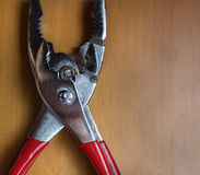 Pair of red handled pliers. Closeup stock images
