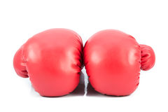 Pair of red leather boxing gloves isolated Stock Photos