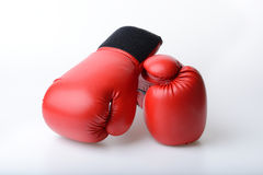 Pair of red leather boxing gloves isolated on white Stock Image