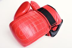 Pair of red leather boxing gloves isolated on white. Sports and championship concep. T royalty free stock photos