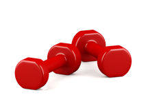 A pair of red light weight dumbbells on white background Stock Image