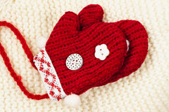 Pair red mittens on white knitted cap Stock Photos