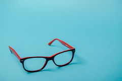 Pair of red plastic-rimmed eyeglasses Royalty Free Stock Images