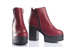 Pair of red platform boots with chunky heels for spring or autum Stock Photos