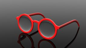 Pair of red round-lens eyeglasses Stock Image