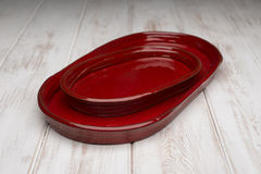 A Pair of Red Rounded Rectangular Deep Dish Stock Image