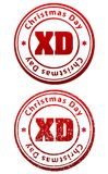 Pair of red rubber stamps in grunge and solid style with caption. Christmas Day and abbreviation XD Stock Images