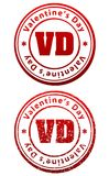 Pair of red rubber stamps in grunge and solid style with caption. Valentine`s Day and abbreviation VD Royalty Free Stock Photos