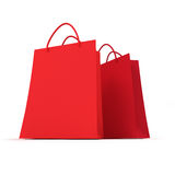 Pair of red shopping bags. 3D rendering of two red shopping bags against a white background Royalty Free Stock Image