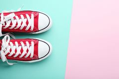 Pair of red sneakers. On colorful background royalty free stock images