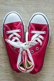 Pair of red sneakers Stock Photo