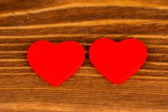 Pair red hearts on rustic wooden background. Pair red valentine`s day hearts on rustic wooden background stock images