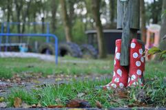 Red and White Polka Dotted Rubber Boots. A pair of red and white polka dotted rubber boots outdoors Royalty Free Stock Photos