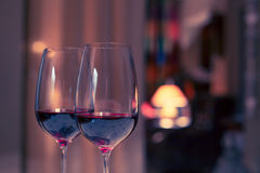 Pair of red wine glasses, closeup shot Stock Images