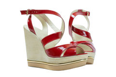 A pair of red women's sandals on a white background. A pair of red women's sandals Stock Image