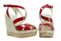 A pair of red women's sandals on a white background. A pair of red women's sandals Stock Photo