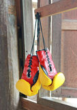 Pair of red-yellow boxing gloves Hanging Stock Photography