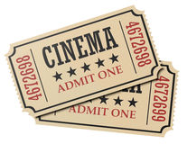 Pair of retro cinema tickets isolated. Vintage retro cinema creative concept: pair of retro vintage cinema admit one tickets made of yellow textured paper Stock Photo