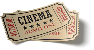 Pair of retro cinema tickets whith shadow. Vintage retro cinema creative concept: pair of retro vintage cinema admit one tickets made of yellow textured paper Royalty Free Stock Images
