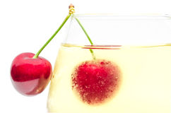 Pair of ripe cherry berries on wineglass Royalty Free Stock Images
