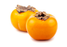 Pair of ripe japanese persimmons Royalty Free Stock Photography