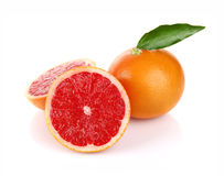Pair ripe juicy grapefruit with green leaf Royalty Free Stock Photo