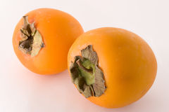 Pair of ripe persimmons. Isolated on white Royalty Free Stock Photography
