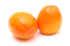 Pair of ripe persimmons Stock Photos