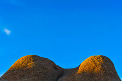 Pair of rocks look like breasts with sky Royalty Free Stock Photography