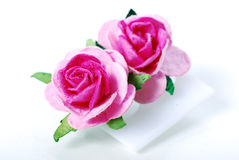 Pair of roses ear ring royalty free stock photo