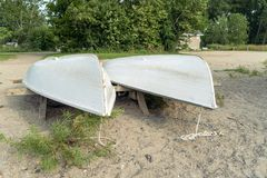 A pair of rowboats on a storage rack royalty free stock image