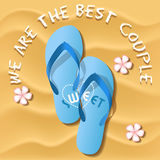 A pair of rubber flipflops on sand beach Royalty Free Stock Photos