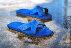 Old sandals on the concrete floor. Royalty Free Stock Photos