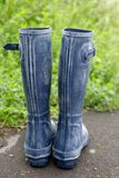 Rubber Wellington boots in the garden stock images