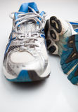 Pair of running shoes. On a white background (shallow DOF; color toned image royalty free stock photos