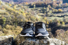 Pair of running shoes in the mountain. Black and white running shoes in the mountain royalty free stock images