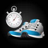 Pair of running shoes and stopwatch Royalty Free Stock Images