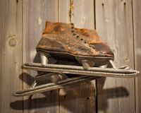 Rustic Brown Antique Ice Skates royalty free stock images