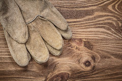 Pair of safety gloves on vintage wooden board construction conce Stock Photography