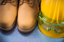 Pair of safety lace boots building helmet and transparent plasti Royalty Free Stock Photography