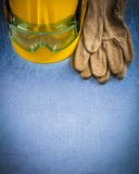 Pair of safety leather gloves building helmet and protective gog Stock Image