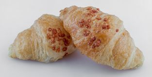 Pair of salted croissant with cheese. On isolated background stock photography