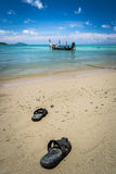 Pair of sandal on the beach Stock Images