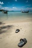 Pair of sandal on the beach Stock Photos