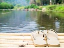 A pair of sandal near the canal Stock Photos