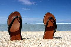 Pair of sandals onthe beach Royalty Free Stock Image